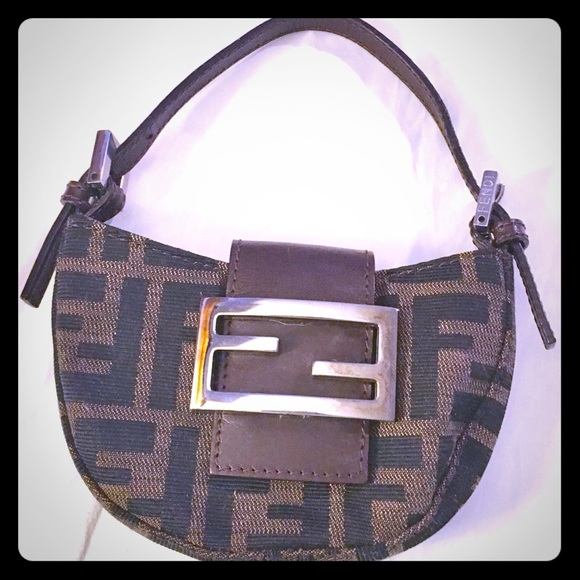 Fendi Handbags - Fendi Vintage Mini Monogram Baguette Clutch Purse a36be5120a095